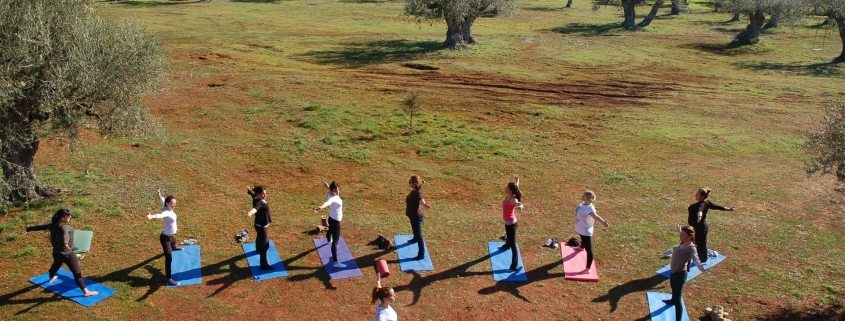 yoga class out in ature at eumelia